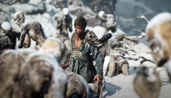 The main character from Black Myth: Wukong wanders between snow-covered, frozen humanoid enemies