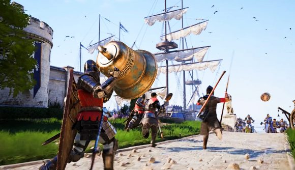A knight in red carries a large brass bell toward a tall-masted ship docked in a medieval harbour.