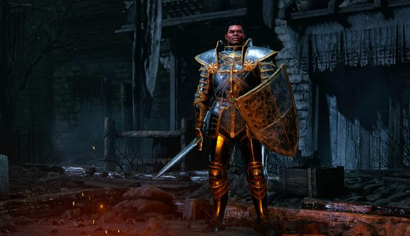 A paladin stands in the ruins of a church in Diablo 2: Resurrected