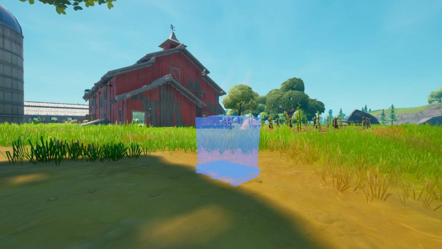 A blue outline of a cat food pallet outside a red barn in Fortnite.