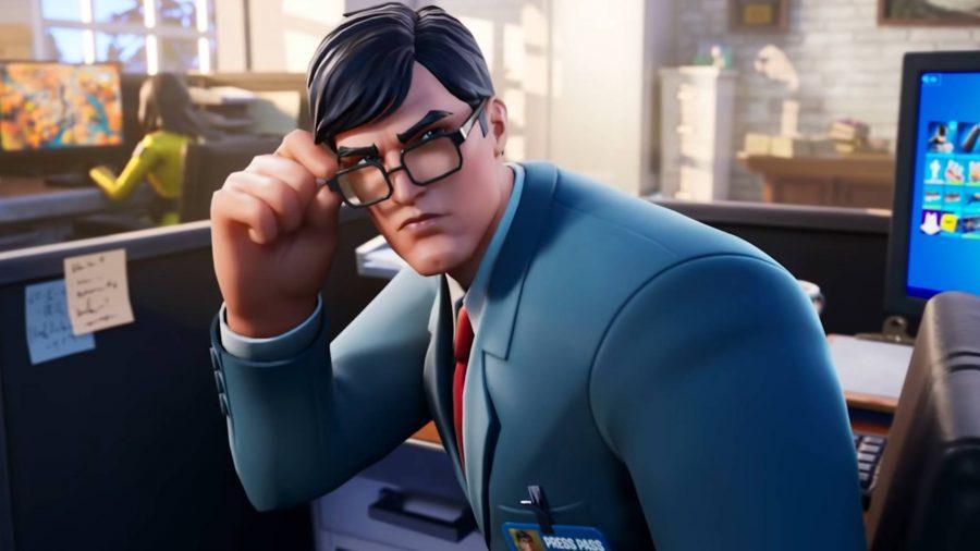 Clark Kent sitting at a desk in Fortnite