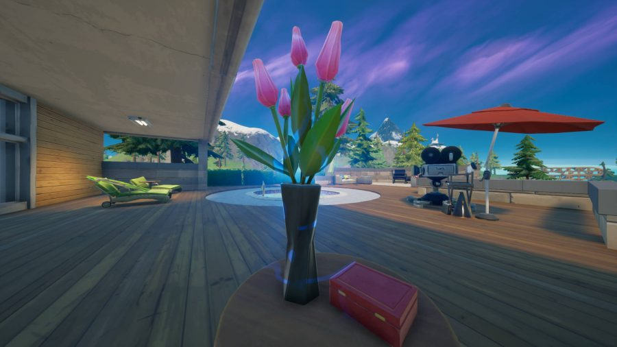 A vase of pink flowers sitting on a table in Fortnite