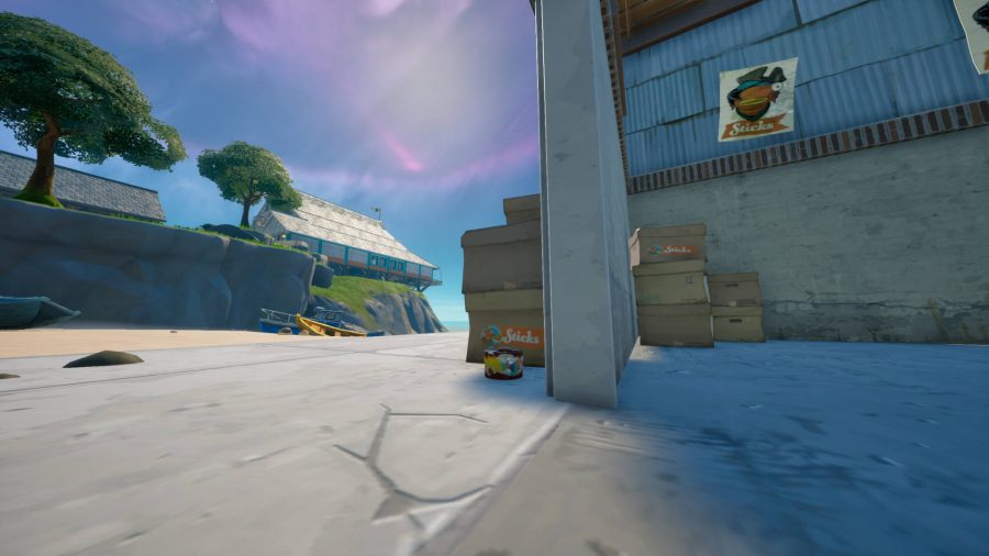A small can of vintage cat food found in Craggy Cliffs in Fortnite. It's by some boxes.