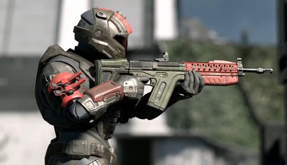 A Spartan readies a rifle in Halo Infinite multiplayer.