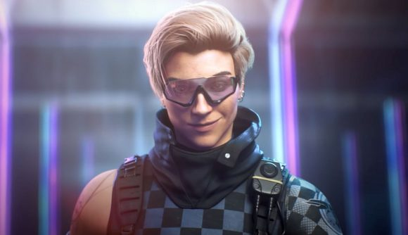 Blonde, short-haired female Rainbow Six Siege Crystal Guard operator Osa wearing futuristic riot kit grins at the camera