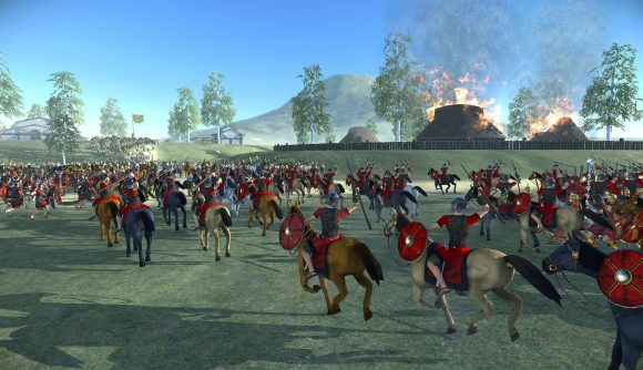 Roman cavalry and infantry charging through a Gallic town