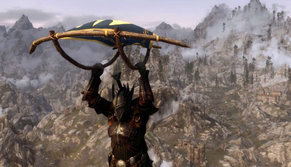 A Breath of the Wild-inspired paraglider mod being used in Skyrim by an armoured Dragonborn