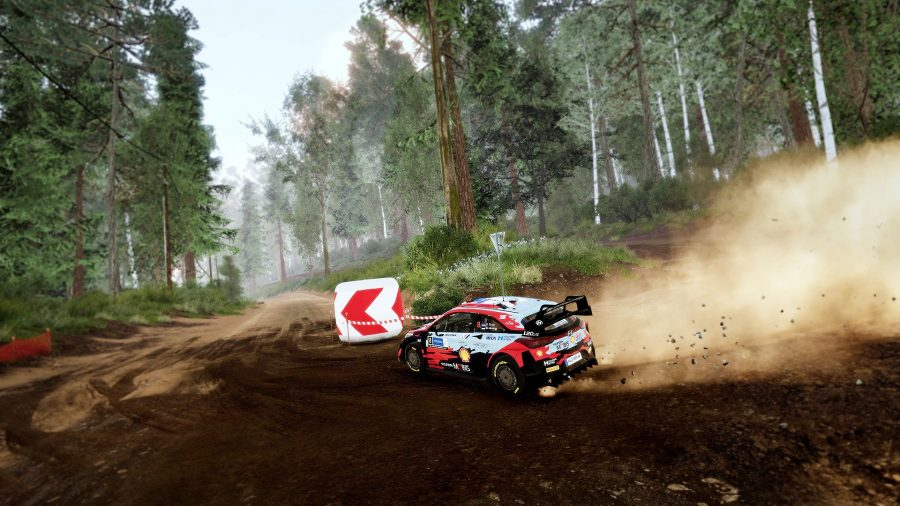 Turning a corner on a dirt track in WRC 10