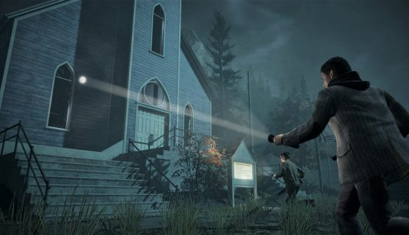 Alan Wake with flashlight outside church at night