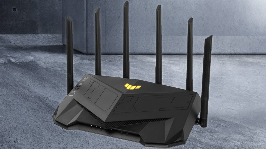 The Asus TUF AX5400 gaming router sits against a grey marble background