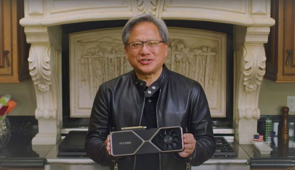 Nvidia's Jensen Huang holding a RTX 3080 graphics card
