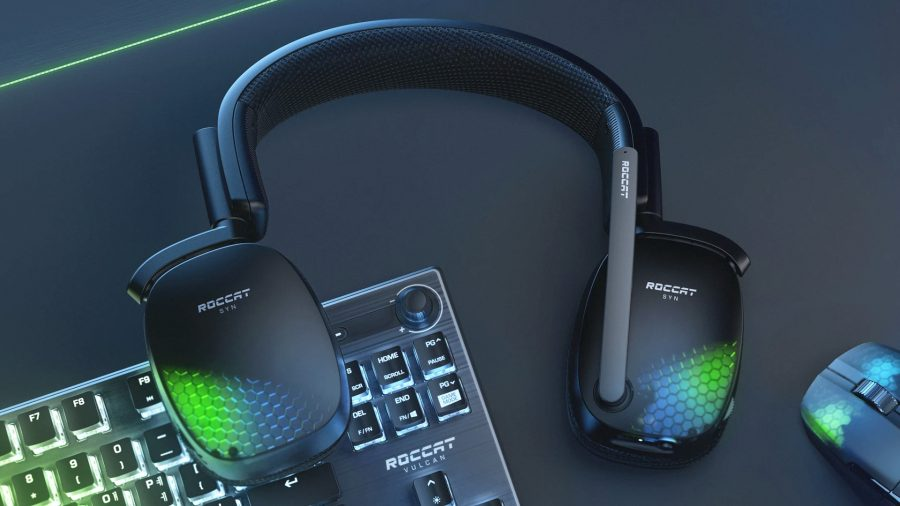 Roccat's Syn Pro Air wireless gaming headset sits atop a gaming keyboard next to a mouse