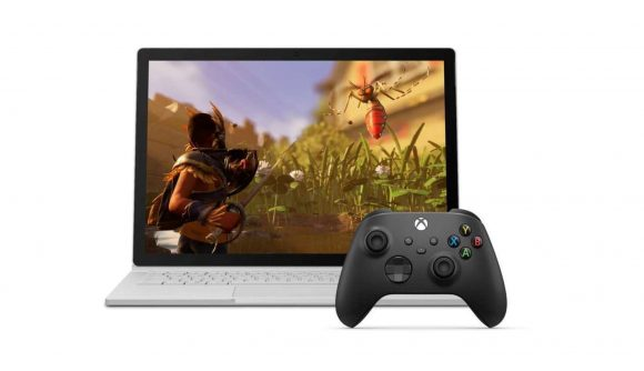 Gaming laptop with black xbox controller on white background