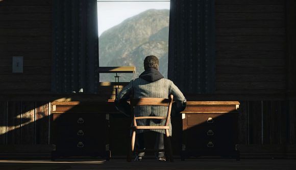 Alan Wake stares out of the window in Alan Wake Remastered