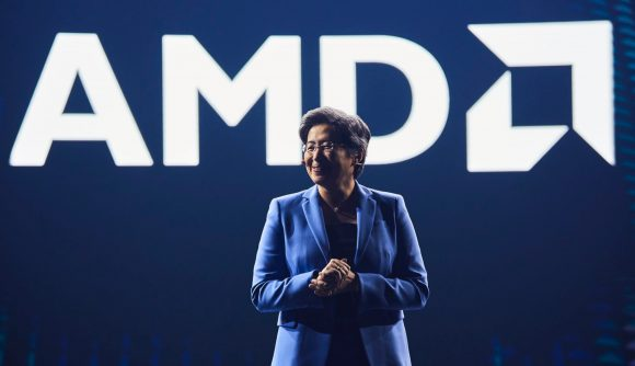 AMD President and CEO, Lisa Su, standing in front of a bright white AMD logo