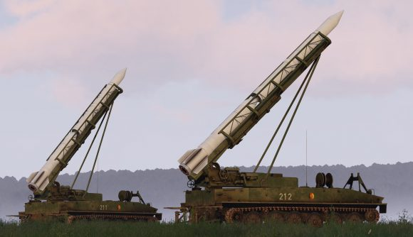 Two SP16 short-range ballistic missile launchers ready their 2K6 Luna missiles in Arma 3.