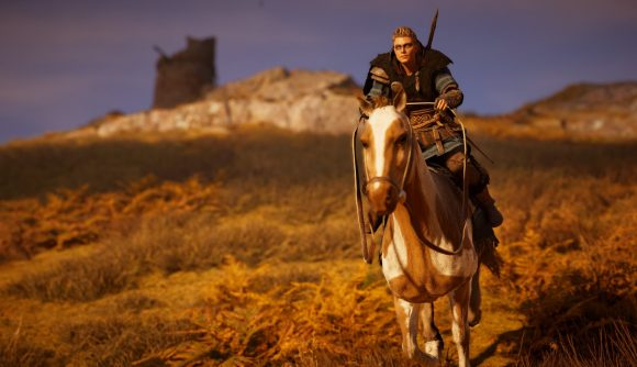 Eivor rides a horse across an open hillside at sunset in Assassin's Creed Valhalla