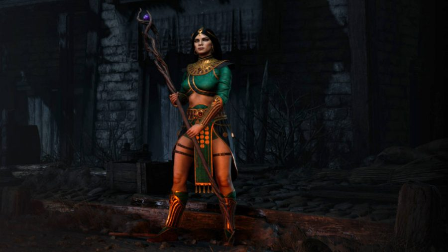 The Sorceress in Diablo 2 Resurrected is holding a staff with both hands.