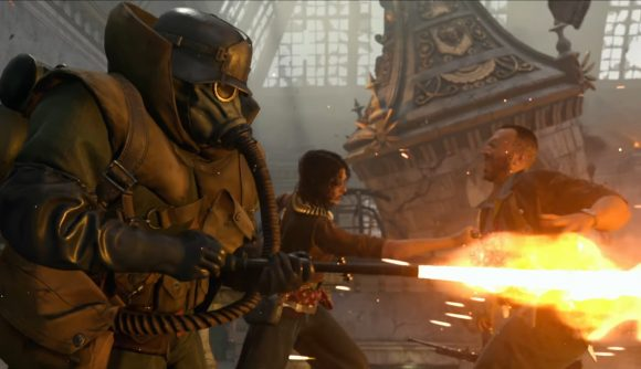 A soldier in a gas mask fires a flamethrower, while two others engage in melee combat in the background, in Call of Duty: Vanguard