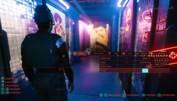 V heads down a neon-lit hallway in Cyberpunk 2077, and the interface for photo mode is displayed over the scene.