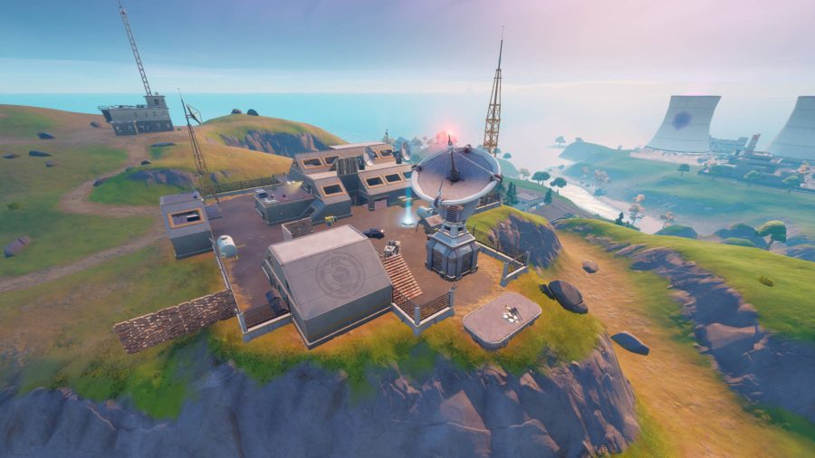The Fortnite mole is inside the satellite station with Steamy Stacks behind it.
