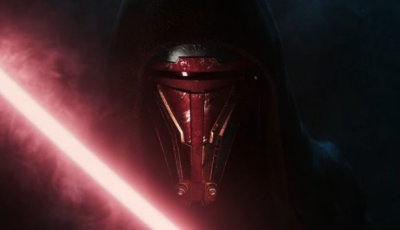 Darth Revan, a central KOTOR character, has his mask lit by the glow of a red lightsaber