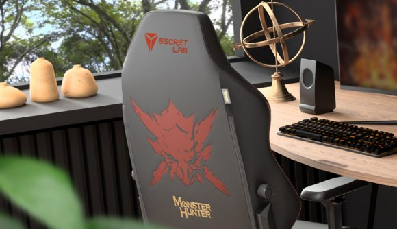 The back of a Secretlab Titan Evo 2022 Monster Hunter Edition gaming chair tucked under a wooden desk