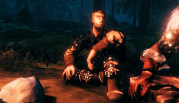 A low-polygon Viking sits by a campfire in Valheim.