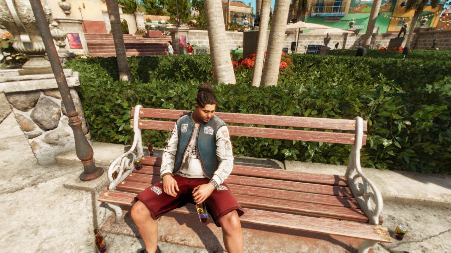 A Far Cry 6 NPC sits on a bench