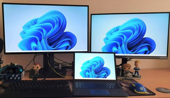 Windows 11 on gaming PC with 2 monitors and a surface pro on top of desk