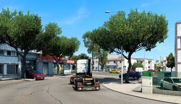 Driving down city street in Euro Truck Simulator 2