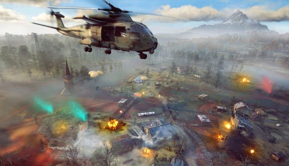 A helicopter flies over a smoke-filled battlefield in Ghost Recon Frontline