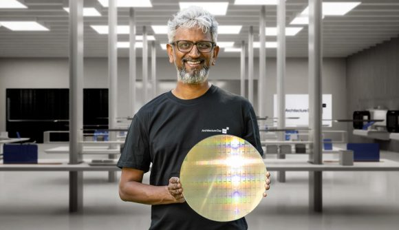 Intel's Raja Koduri holding a chip wafer