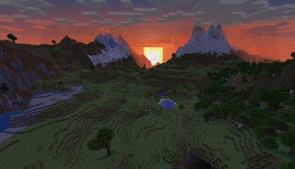 The sun rises from behind some Minecraft mountains.