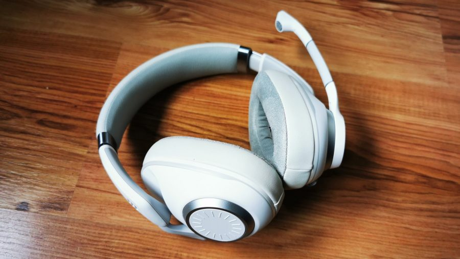 EPOS H6Pro white headset on woodgrain backdrop