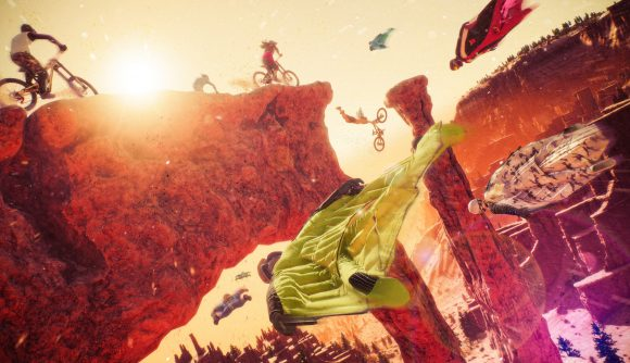 Bikers and wingsuiters speed across a canyon into the sunset in Riders Republic.