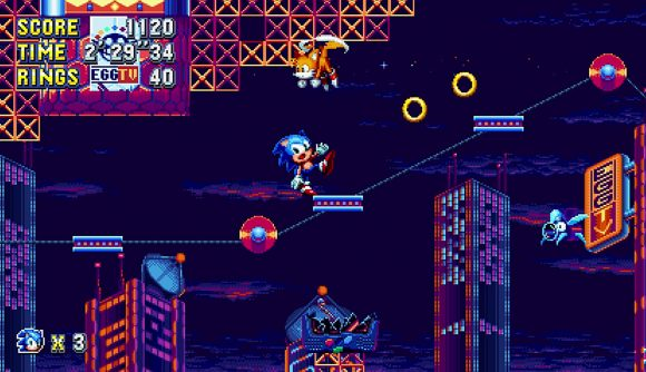 Sonic teeters on the edge of a moving platform in Sonic Mania