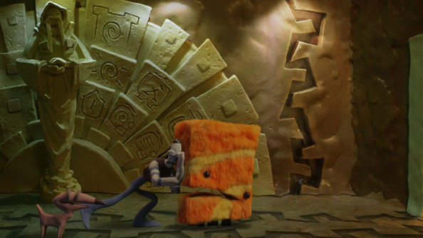 A puppet pushes a fuzzy, self-aware cube.