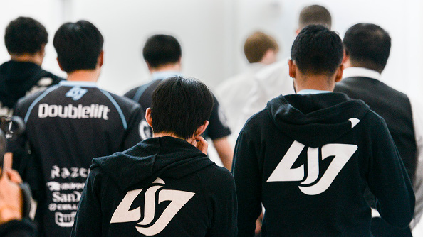 The CLG team walking down a hall looking defeated.