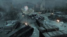 British forces storm a French factory outside Caen in Company of Heroes