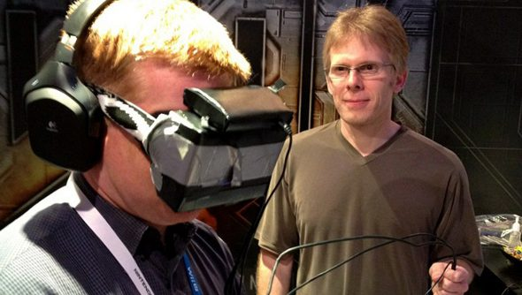 John Carmack stands next to a person wearing an Oculus Rift.
