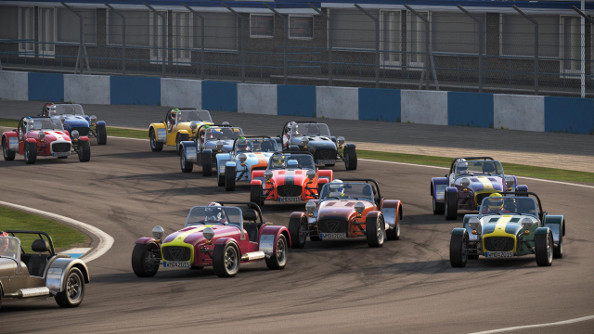 A field of Caterham racers at the start of a lap.