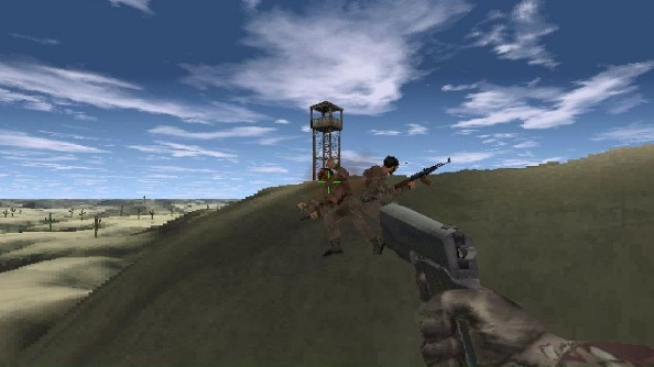 A blurry screenshot of a large pistol being used to shoot two pixelated soldiers in the back on a desert hillside.