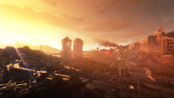 A sunset over a gold-white city viewed from a distant rooftop.