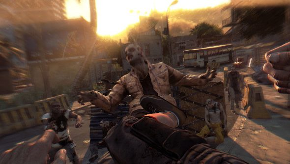 A zombie rears back after being smacked with a kick emerging from the bottom of the frame.