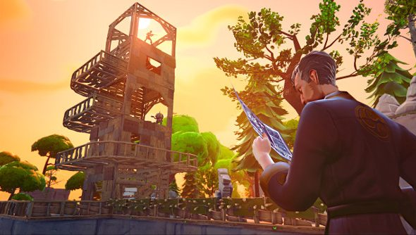 A handsome ninja looks at blueprints while a tower takes shape in the sunset skyline in the background.