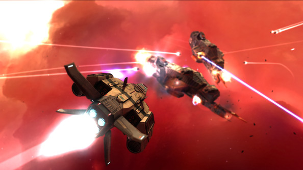 Intense and fiery spaceship combat against a glowing nebula.