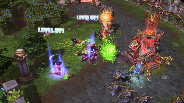 A number of heroes level up during a battle on a cartoony green battlefield dotted by towers and tiny warriors in red and blue capes.