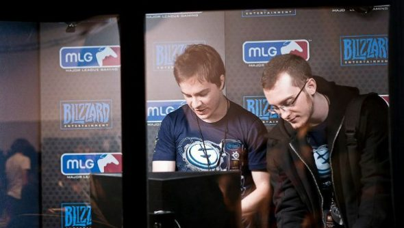 Two Evil Geniuses progamers in a booth at the 2012 BWC tournament.