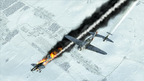 A Russian fighter shoots down a German Stuka, which trails thick black smoke and bright flame.